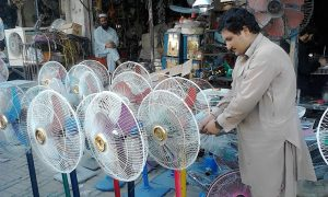 rechargable fan, photo by Arshad Khan