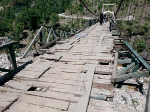 A view of the wooden bridge that needs immediate attention of authorities. - Photo by Sarfaraz Khan