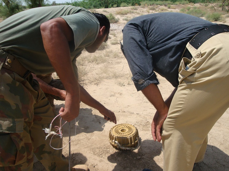 Bomb disposal unit personnel defusing two bombs in Tank. - Photo by Ayub Bhetani